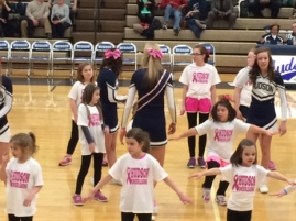 Bay cheerleading at the Varsity Basketball game